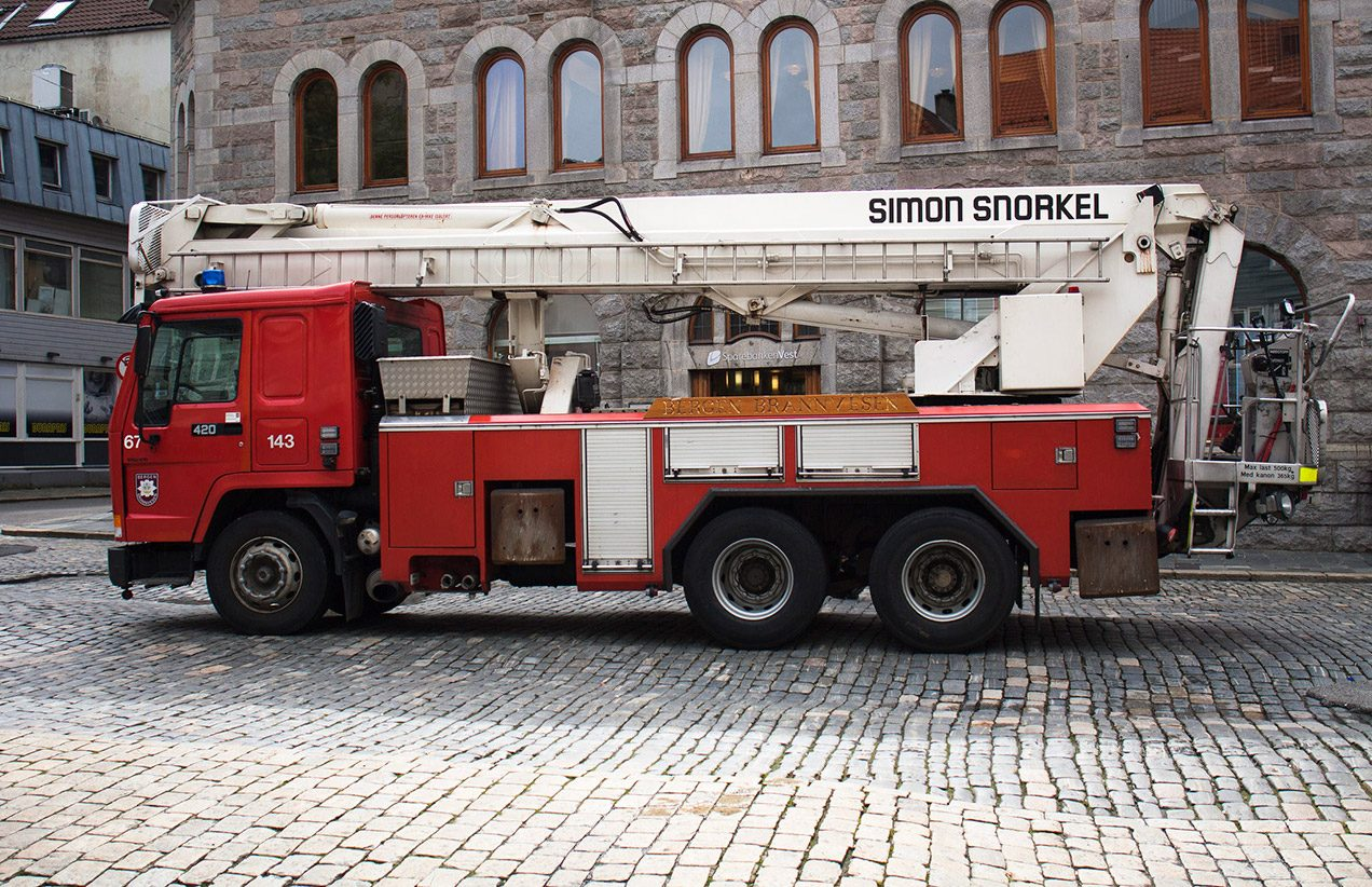 Photo of a bright red Norwegian fire truck