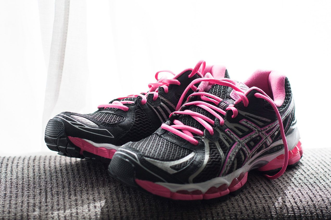 Black and pink Asics running sneakers