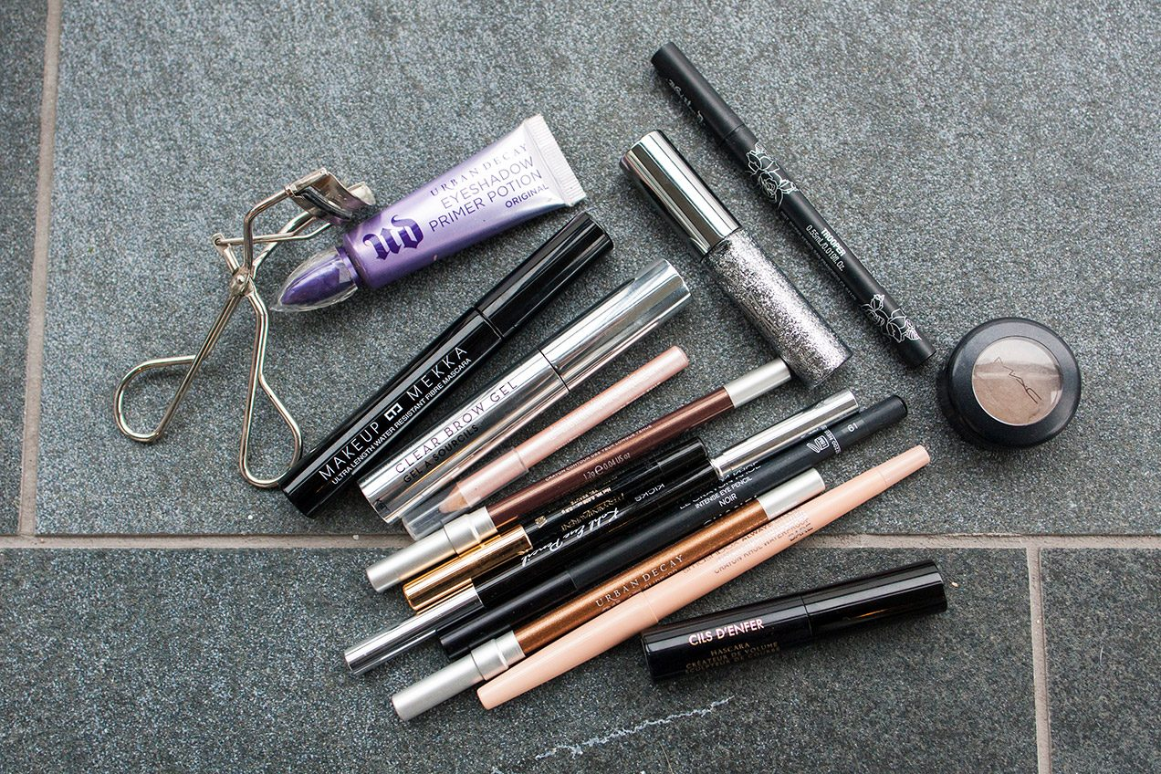 Photo of makeup products scattered on the floor